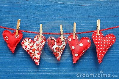 Red hearts with clothespins