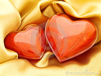 Red hearts at gold
