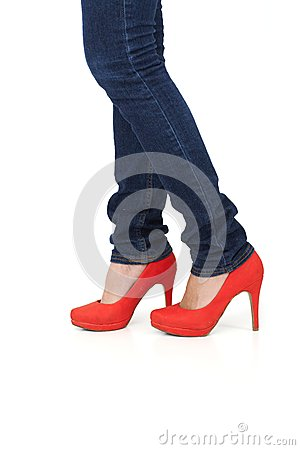 Red high heel shoes and jeans
