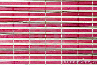 A red horizontal bamboo mat.
