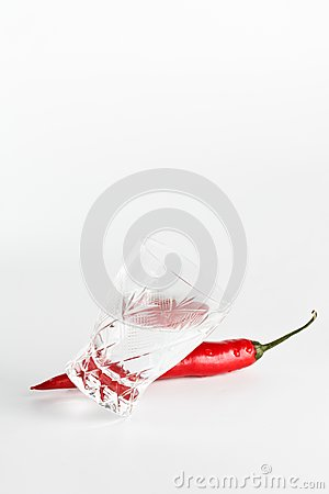 Red hot chili pepper with crystal glass