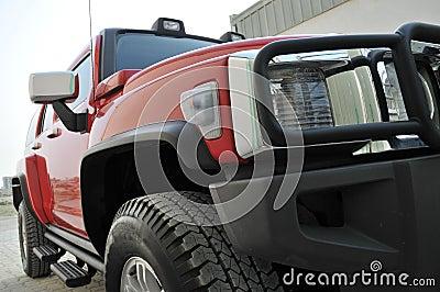 Red Hummer H3 Side