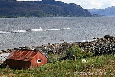 Red hut at a coast in norway