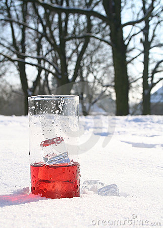 Red, icy drink in snow