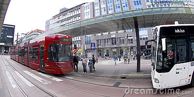 Red Innsbruck tram and white bus Editorial Photography