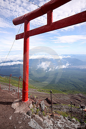 Red Japanese tori gate on top of Mt. Fuji