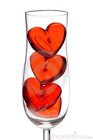 Red jelly hearts in champagne glass
