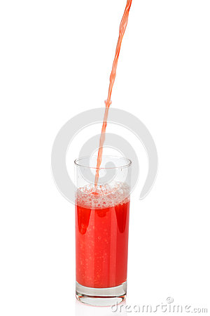 Red juice pouring in glass