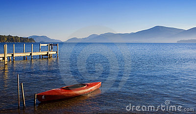 Red Kayak on Blue Water