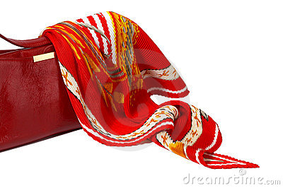 Red ladies handbag and scarf isolated on white