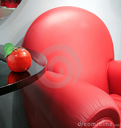 Red leather chair and apple
