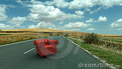 Red leather club armchair on the road