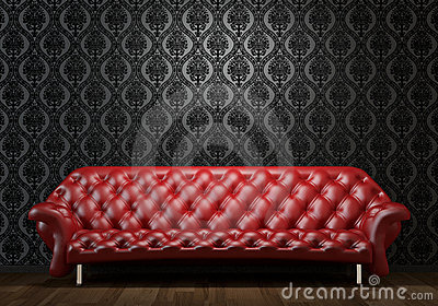 Red leather couch on black wall