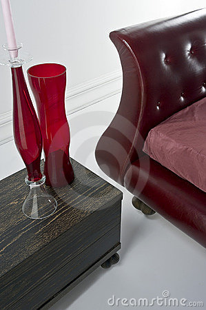 Red leather sofa with glass