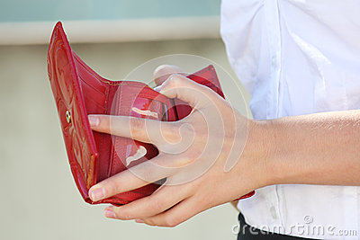 Red leather wallet in female hands