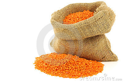 Red lentils in a burlap bag