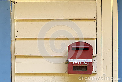 Red letter box on wood background
