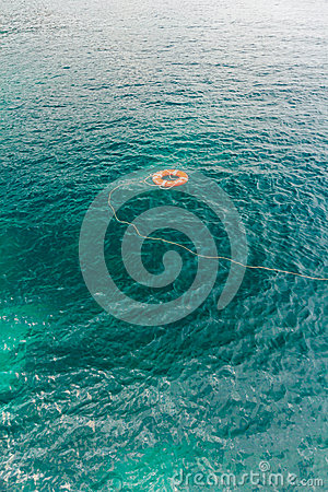 Free Red Life Buoy In The Water Stock Images - 30550364