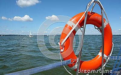 Red lifebuoy on yacht