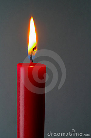 Red lighted candle with clipping path