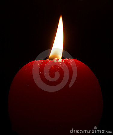 Red lighting candle with small drops