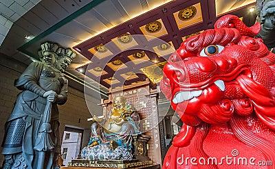 Red lion and chinese Buddha