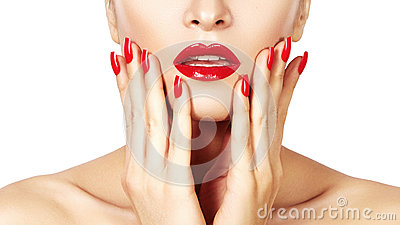 Red lips and bright manicured nails. open mouth. Beautiful manicure and makeup. Celebrate make up and clean skin Stock Photo