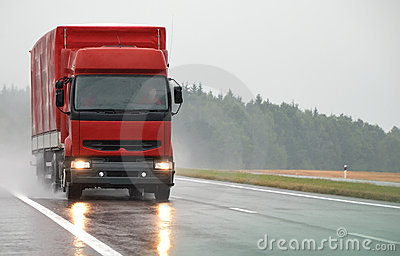 Red lorry on wet road