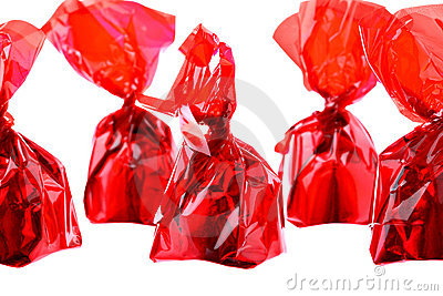 Red luxury sweets in zig-zag row isolated on white