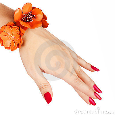 Red manicure and orange bracelet