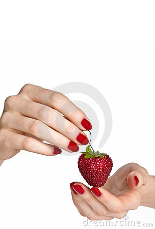 Red manicure and strawberry