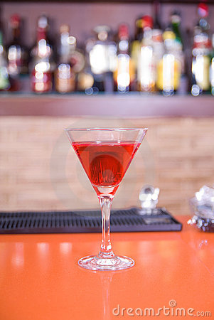 Red martini drink cocktail in a bar