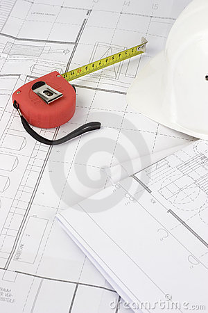 Red measuring tape on construction plans