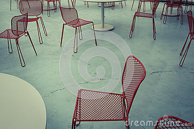 Red metal chairs on concrete floor