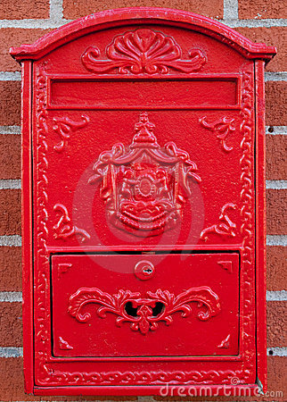Red Metal Mailbox on brick wall