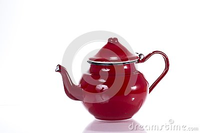 Red metallic teapot isolated