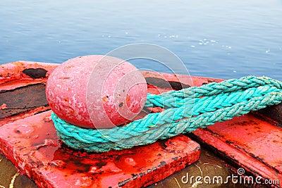 Red mooring bollard