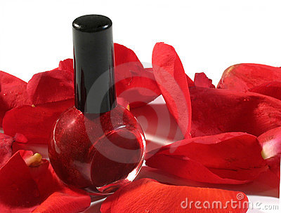 Red nail polish with rose petals