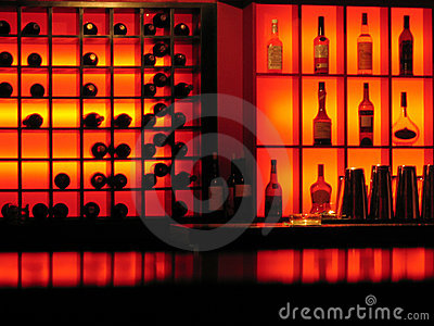 Red nightclub bar glowing bottles background
