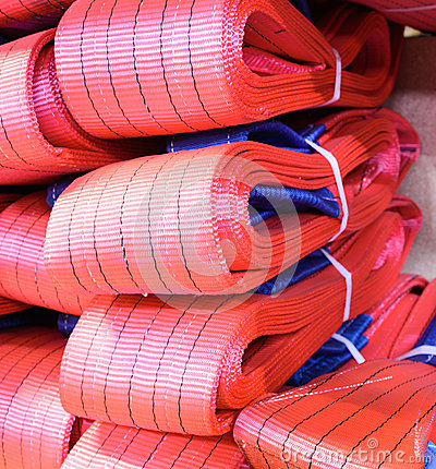 Free Red Nylon Soft Lifting Slings Stacked In Piles. Stock Photo - 81867120