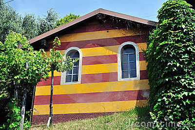 Red ochre and yellow striped shed, Lombardy, Italy