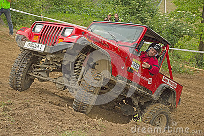Red off-road car on top of a steep hill Editorial Image
