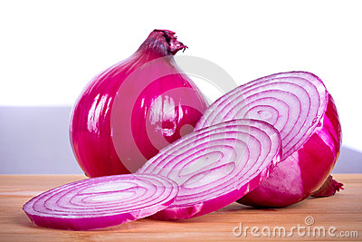 Red onion sliced on cutting board