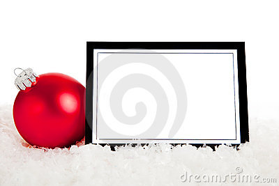 A red ornament with blank notecard