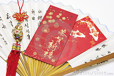 Red Packets and Trinket on Paper Fan