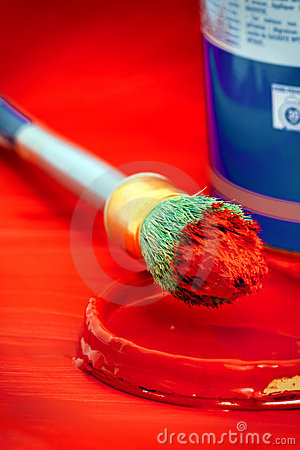 Red paint on brush with tin