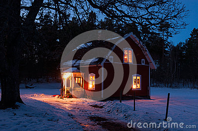 Red painted wooden house in Sweden at night