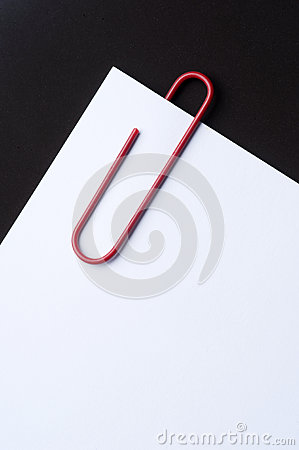 Red paper clip and paper