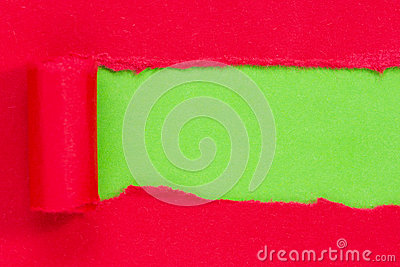 Red paper torn to reveal green panel