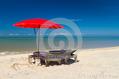 Red parasol on the tropical beach
